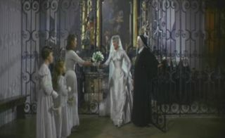 Sound_of_Music_-_maria_wedding_dress__gate_grabs_bouquet