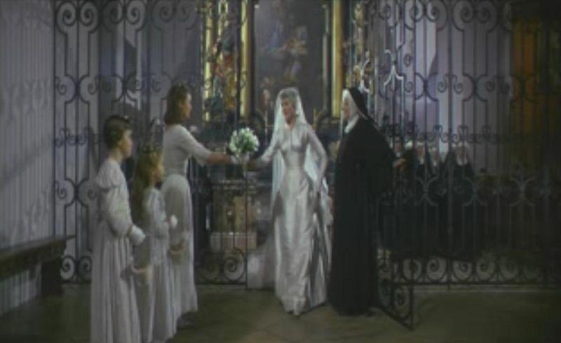 Sound_of_Music_-_maria_wedding_dress__gate_grabs_bouquet
